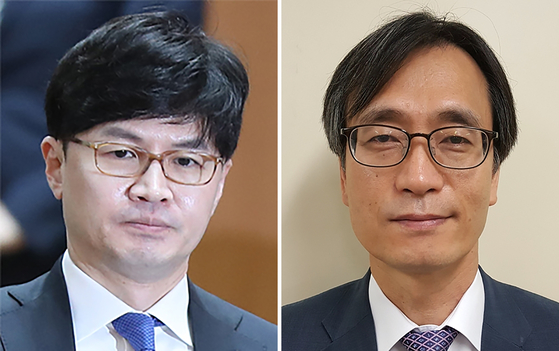 A brawl breaks out on Wednesday between Han Dong-hoon, left, and Jeong Jin-ung as Jeong tried to confiscate Han's mobile phone as a part of an investigation into the suspicion that Han had colluded with a reporter to blackmail a possible witness.  [YONHAP]