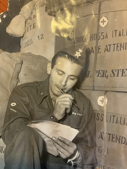 Gianni Riboldi, writing a letter to a friend during his service in Korea at the Italian field hospital during the war. [GIANNI RIBOLDI]