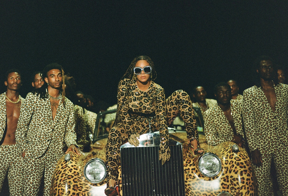 "This image released by Disney Plus shows Beyonce Knowles, center, in a scene from her visual album ""Black is King."" [AP/YONHAP]"
