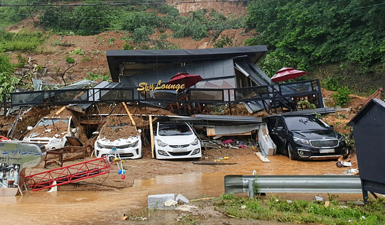 This photo, provided by authorities in northern Gyeonggi, shows holiday lodgings engulfed by a landslide in Gapyeong, Gyeonggi, on Monday. Three people were reportedly killed in the landslide. [NEWS1]