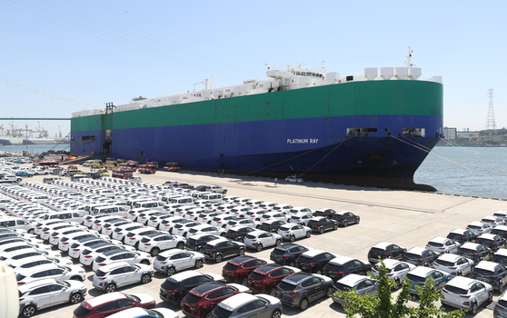 A ship ready to transport Hyundai Motor's cars is anchored in a port. [YONHAP]