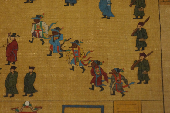 A close-up photo of a painting part of of National Treasure No. 325 shows ritual dancers hired at a gathering of court officials during the Joseon Dynasty. [ESTHER CHUNG]