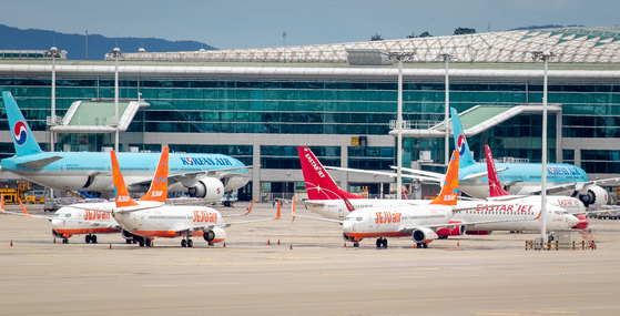 Jeju Air planes are parked at Incheon International Airport last month. [NEWS1]