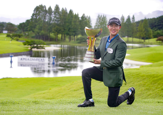 Kim Seong-hyeon poses for a photo with a trophy after picking up a win at the 63rd KPGA Championship with A-One Country Club. [KPGA]
