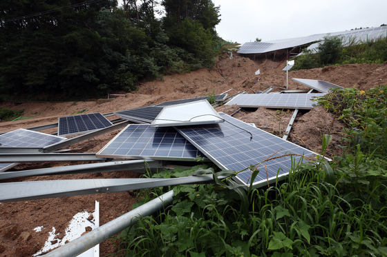 A solar power plant in Jecheon, North Chungcheong, is damaged following a landslide Saturday afternoon. [YONHAP]