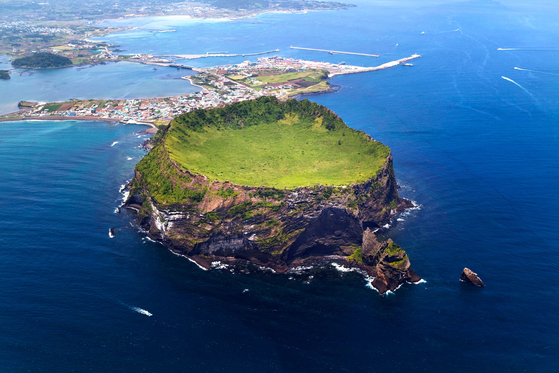 Seongsan Ilchulbong is an archetypal tuff cone formed about five thousand years ago by hydrovolcanic eruptions that occurred in the shallow sea. [JEJU WORLD NATURAL HERITAGE CENTER]