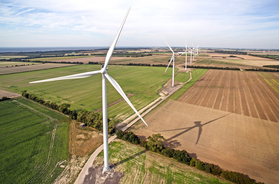 A wind farm at Rodby Fjord, Denmark. Photo provided at the courtesy of Vestas Wind Systems. [VESTAS WIND SYSTEMS]