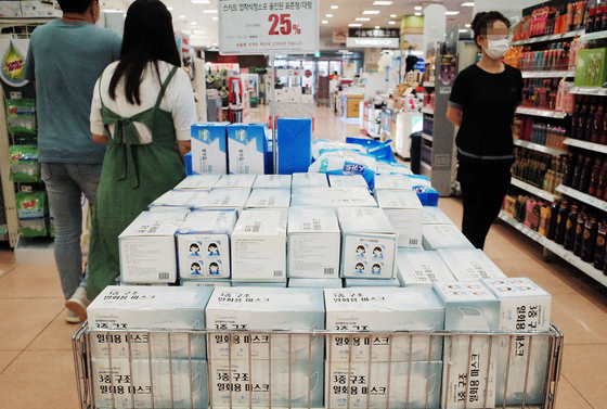 Face masks are displayed at a major discount mart in Seoul on Wednesday. [YONHAP]