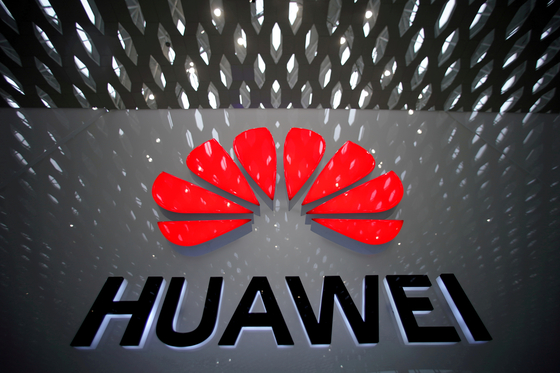 A Huawei company logo is pictured at the Shenzhen International Airport in Shenzhen, Guangdong Province, China on July 22, 2019. [REUTERS]