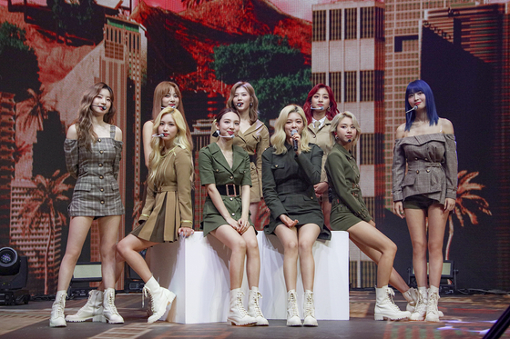 "Girl group Twice performs during its first online concert 'Beyond LIVE ? Twice: World in A Day"" held on Sunday afternoon through Naver V Live. [JYP ENTERTAINMENT]"