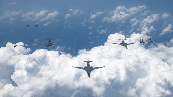 U.S. B-1B bombers fly alongside other U.S. and Japanese fighters in an aerial operation near the Korean Peninsula and Japan on Monday, in a photograph from the U.S. Indo Pacific Command website. [YONHAP]