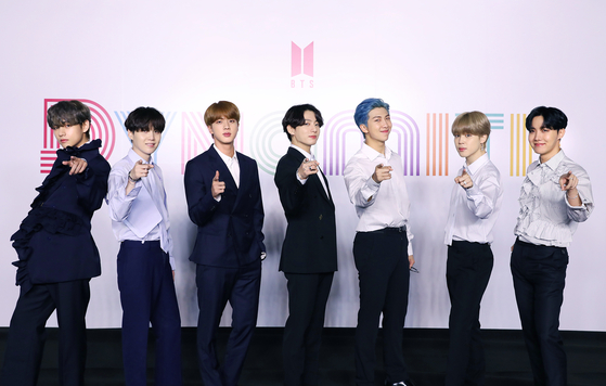 """BTS poses for photos at an online press conference held on Friday morning prior to the release of its new digital single """"Dynamite."""" [BIG HIT ENTERTAINMENT]"""