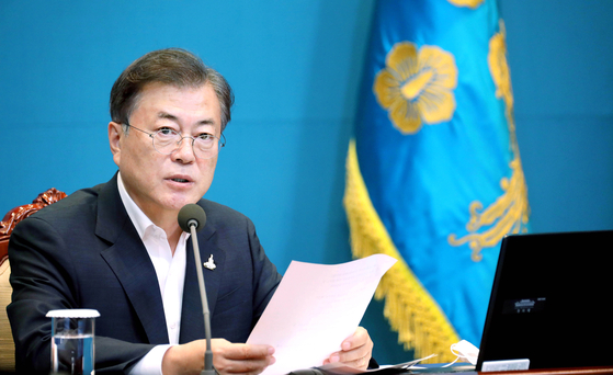 During a weekly meeting at the Blue House in August, President Moon Jae-in claims the overheated real estate market has started to calm down. [JOINT PRESS CORPS]
