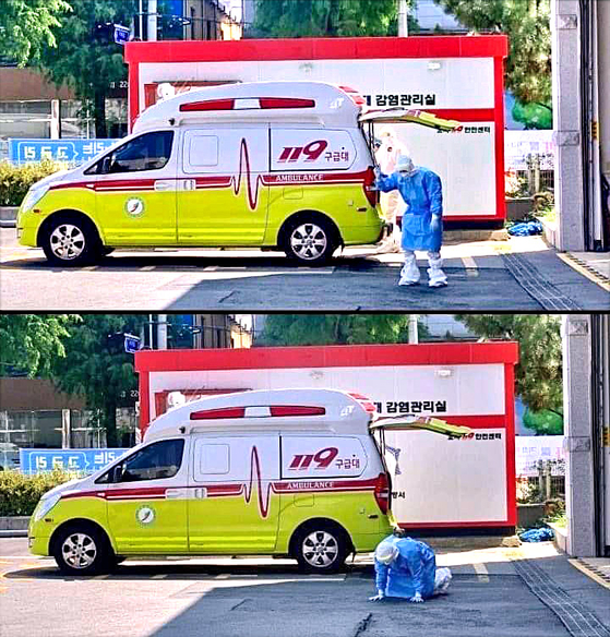 A medical professional sinks to the floor Sunday due to dehydration near a fire station in Jeonju, North Jeolla, as health authorities reported a new five-month high of daily coronavirus cases. [YONHAP]