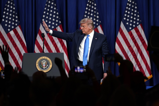 U.S. President Donald Trump stands on stage after speaking during the first day of the Republican National Committee Convention Monday, Aug. 24, in Charlotte, North Carolina. [AP]