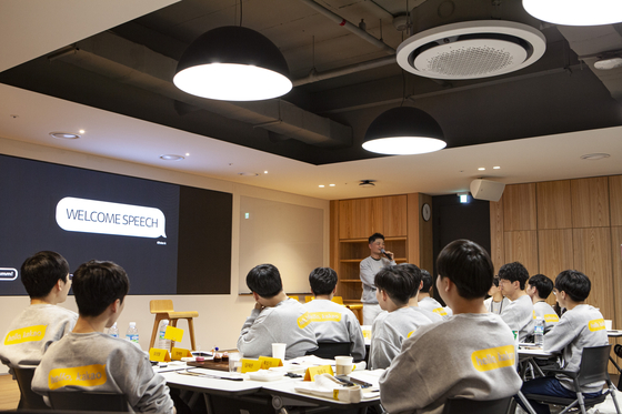Kakao founder Kim Beom-soo speaks to new employees in November 2019. [KAKAO]