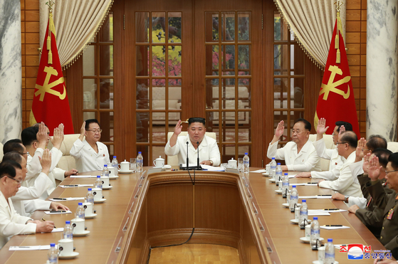 North Korean leader Kim Jong-un, center, convenes a Politburo meeting of the North's ruling Workers' Party Central Committee to discuss preparations for Typhoon Bavi, which is expected to make landfall in the country late Wednesday evening. [YONHAP]