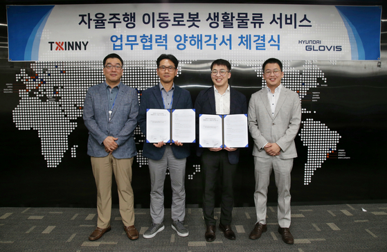 From second from left: Lee Hyoun-mok, head of global logistics center at Hyundai Glovis, stands with Twinny co-CEOs Cheonn Hong-seok and Cheon Young-seok. [HYUNDAI GLOVIS]