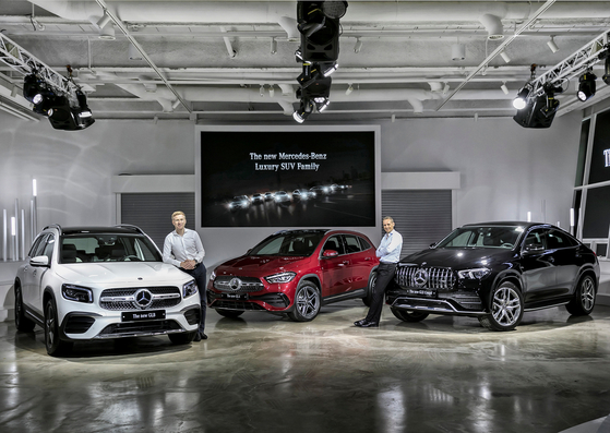 Mark Raine, vice president of product and marketing at Mercedes-Benz Korea, right, and Johannes Schoen, director of planning, price and product strategy, pose beside three SUVs the carmaker unveiled through an online event in Korea, Thursday. The new Mercedes-Benz GLB, new Mercedes-Benz GLA and the new Mercedes-Benz GLE Coupe extend the brand's SUV lineup in Korea to nine models. The products unveiled Thursday are priced between 54 million and 119 million won ($46,000 and $100,000). [MERCEDES-BENZ KOREA]