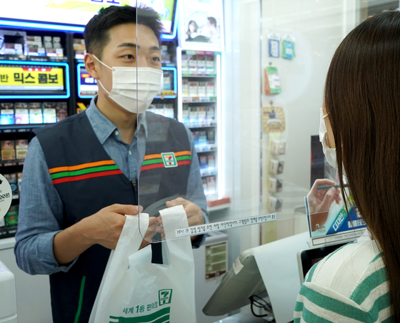 7-Eleven plans to install barriers at stores nationwide to limit the possibility of infection. [7-ELEVEN]