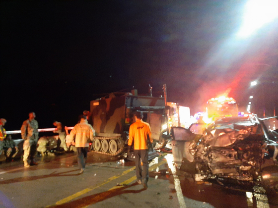 The accident site in Pocheon, Gyeonggi, where an SUV carrying four passengers hit the back of a U.S. armored vehicle Sunday morning. All four people were killed. [GYEONGGI NORTH FIRE DEPARTMENT]