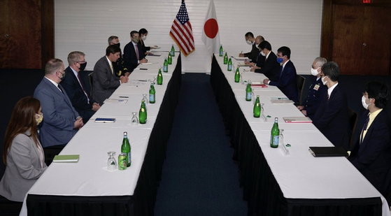 U.S. and Japanese defense chiefs and officials hold a bilateral conference at the Andersen Air Force Base in Guam on Saturday. South Korea was originally invited to the meeting but declined to attend. [U.S. DEPARTMENT OF DEFENSE]