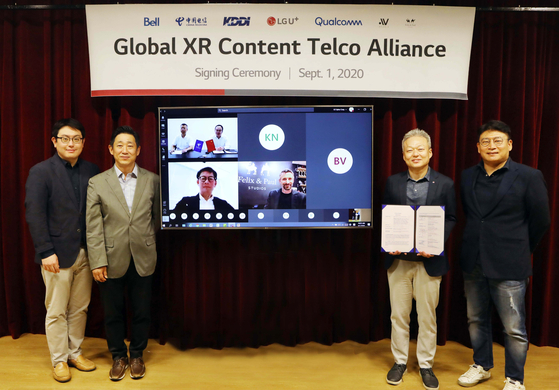 LG U+ executives pose with XR Content Telco Alliance partners after signing an agreement on Tuesday at the company's headquarters in Yongsan, central Seoul. [LG U+]
