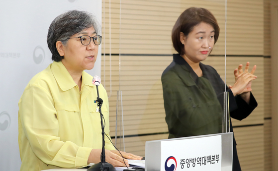 Jung Eun-kyeong, director of the Centers for Disease Control and Prevention, holds a press briefing with a sign language interpreter on Aug. 31. [NEWS1]
