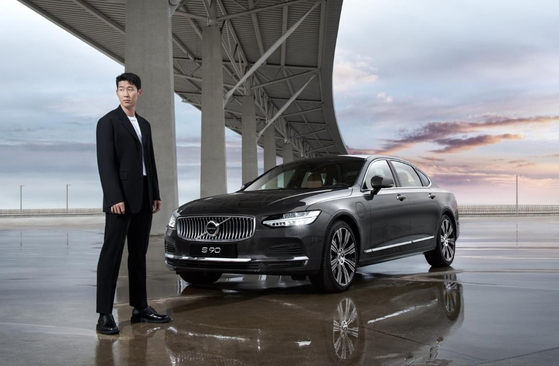Korea's soccer player Son Heung-min poses with Volvo's partially revamped S90 sedan which he models for. [VOLVO KOREA]