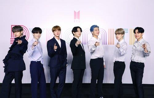 "Boy band BTS poses for photos ahead of the online press conference held on Aug. 21 for its new digital single ""Dynamite."" [BIG HIT ENTERTAINMENT]"