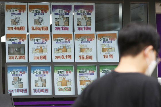 A man walks past a real estate agency in Mapo District, western Seoul, on Tuesday. According to the Korea Appraisal Board, Seoul apartment prices in August rose 0.68 percent from the previous month, setting a record for the highest on-month jump since December 2015. [YONHAP]