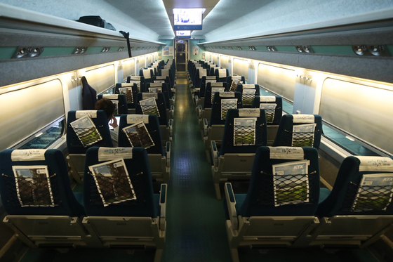 A passenger sits on an empty Korea Railroad (Korail) train from Seoul to Busan on Wednesday. Korail said the hotly contested ticket reservation period for the upcoming Chuseok holiday, that was originally scheduled for Wednesday and Thursday this week, has been pushed back to Sept. 8 to 9 due to Covid-19 concerns. [YONHAP]