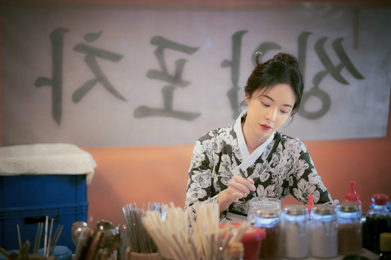 Hwang as Weol-ju, a centuries-old bar owner who is tasked with resolving the troubles of 100,000 customers if she wants to be reincarnated into a new life. [JTBC]