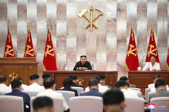 North Korean leader Kim Jong-un addresses officials during an enlarged meeting of the North's ruling Workers' Party Central Military Commission (CMC) on Tuesday, held to discuss measures to relieve the damage caused by Typhoon Maysak. [YONHAP]