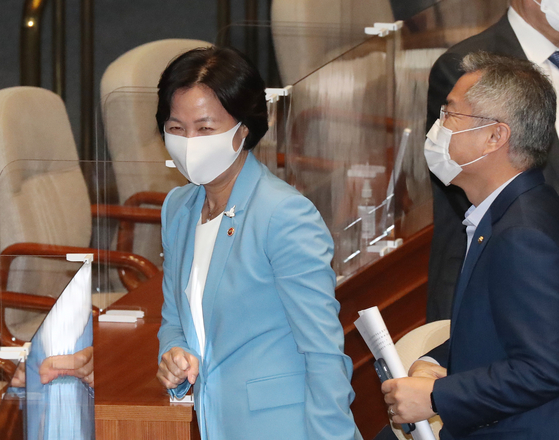 Justice Minister Choo Mi-ae, left, leaves the National Assembly's main hall after she listened to a speech by Rep. Joo Ho-young, floor leader of the main opposition People Power Party. [YONHAP]