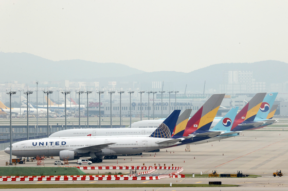 Asiana Airlines aircraft are parked at Incheon International Airport on Sept. 11. [YONHAP]