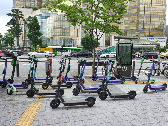 Electric scooters are parked in front of exit 1 of Jamsil Station in southern Seoul. [PARK MIN-JE]