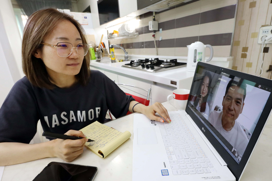 An LG U+ employee works from home. [YONHAP]