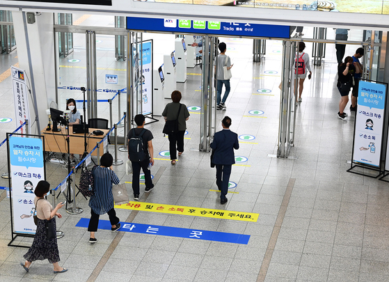 Korea Railroad employees implement disinfection measures at Seoul Station. [KORAIL]