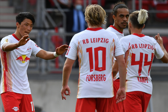 Hwang Hee-chan of RB Leipzig, left, celebrates with his teammates after scoring his first goal of the season during the DFB-Pokal Cup against FC Nurnberg in Nuremberg,Germany, on Saturday. [EPA/YONHAP]