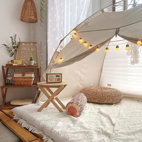 A room is decked with camping gear. [LEE HYEON-AH]
