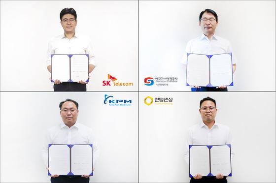 Representatives from SK Telecom, Korea Gas Corp., Quantum Sensing and Korea Plant Maintenance pose with their agreement on Tuesday. [SK TELECOM]
