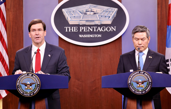 U.S. Secretary of Defense Mark Esper, left, and Korean Defense Minister Jeong Kyeong-doo at a press conference following bilateral alliance talks in Washington in February. [YONHAP]