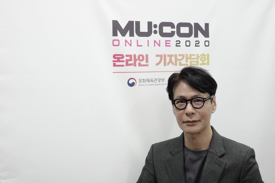 Singer and songwriter Yoon Sang, who is also this year's MU:CON art director, poses for photos prior to an online interview with the local press on Wednesday afternoon. [KOCCA]