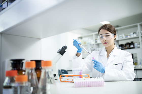 A Celltrion researcher conducts tests at the company's headquarters in Incheon. [CELLTRION]