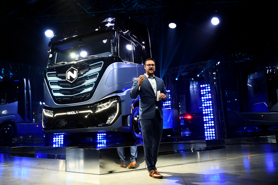 Trevor Milton who recently resigned as the executive chairman of Nikola speaks during presentation of its new full-electric and hydrogen fuel-cell battery trucks in partnership with CNH Industrial, at an event in Turin, Italy, December 2, 2019. [REUTERS]