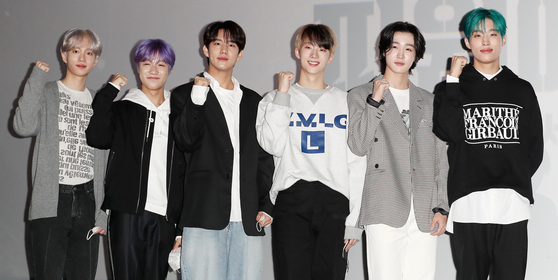 """Members of P1Harmony pose for photos on Monday for the press preview for the movie """"P1H: A New World Begins"""" at the Lotte Cinema Konkuk University branch in eastern Seoul. From left: Theo, Jongseob, Intak, Jiung, Soul and Keeho. [NEWS1]"""