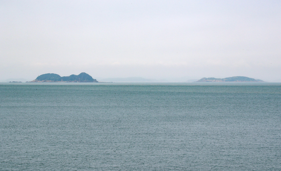 North Korean islands off the country's western coast, seen from South Korea's Large Yeonpyeong Island in June. [YONHAP]