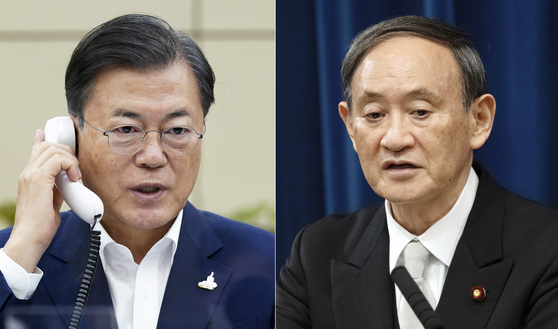 President Moon Jae-in, left, and Japanese Prime Minister Yoshihide Suga had their first phone conversation on Thursday. [YONHAP]