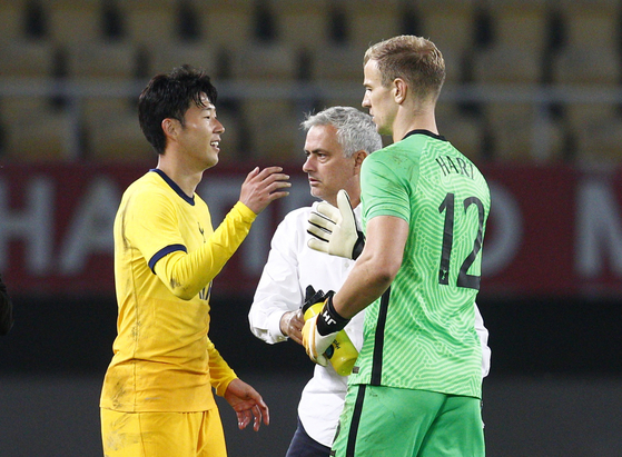 Son Heung-min of Tottenham Hotspur, left, celebrates with his Joe Hart and head coach Jose Mourinho after scoring the club's second goal of the match against Shkenjija during the third-round qualifying match at the UEFA Europa League at National Arena Todor Proeski in Skopje, North Macedonia on Thursday. [REUTERS/YONHAP]